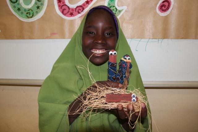 Rahanatou with her Joseph, Mary, and baby Jesus